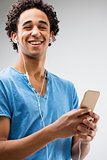happy young man holding a smartphone