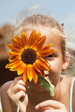 Young girl funny portrait with flower