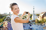 Woman tourist taking photo with photo camera in Park Guell