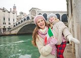 Mother and daughter with Italian flag near Ponte di Rialto