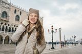 Smiling young woman tourist on St. Mark's Square, Venice