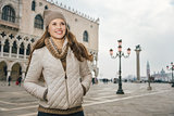 Smiling woman tourist standing on St. Mark's Square, Venice
