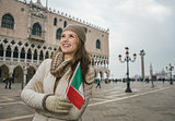 Woman tourist with Italian flag standing near Dogi Palace
