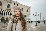 Woman tourist talking mobile phone on St. Mark's Square, Venice
