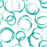 Seamless pattern with distressed dry brush circles and spots