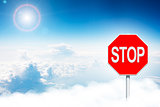 Road sign stop in clouds