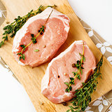Fresh Raw Pork Meat Steaks with Herbs