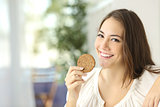 Happy girl showing a dietetic cookie