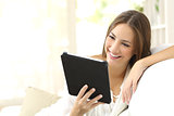 Woman reading ebook at home