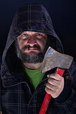 Hooded tough guy holding axe