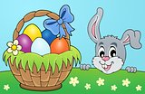 Decorative egg basket and lurking bunny