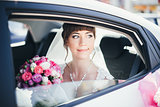 close-up portrait of a bride in car window