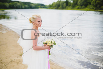 Bride on a background of the river