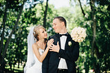 Bride and groom outdoors on a wedding day in park