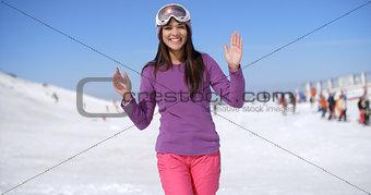 Happy young woman at a ski resort