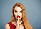 Hush. Sexy Woman with Finger on her Lips.