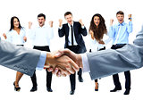 handshake on a background of a happy group of people