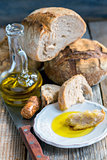 Plate with olive oil and homemade bread.