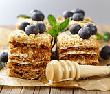 homemade honey cake with blueberries and mint