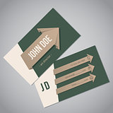 Green business card with arrow ribbons