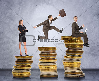 Business people on coins