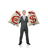 Businessman holding two money bags