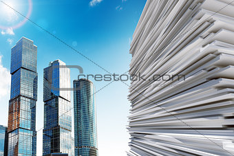 Skyscraper with pile of paper