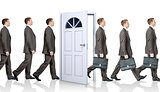 Line of businessmen going through door