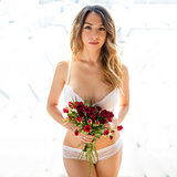 girl standing in underwear with flowers