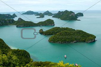 Green islands, sea and tourist ship