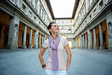 Happy young woman tourist having a walk tour in Florence, Italy