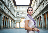 Young woman tourist enjoying attractions of Florence, Italy