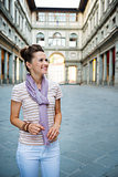 Happy woman tourist enjoying attractions of Florence, Italy