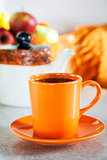 Colorful orange cup of  black tea