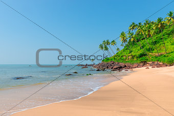 calm ocean and fine sand on the shore