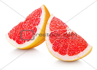 Slices of grapefruit citrus fruit isolated on white