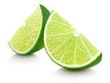Slices of lime citrus fruit isolated on white