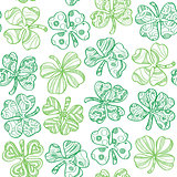 Seamless pattern with shamrock on white background.
