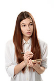 young woman holding a notepad and pen