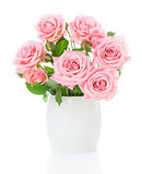 Beautiful bouquet of fresh pink roses in a white vase