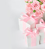 Festive composition of flowers and gifts