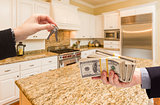 Handing Over Cash for Keys Inside Beautiful Kitchen