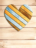 Wooden heart on old wood wall