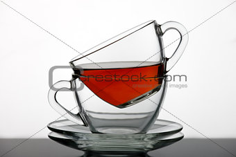 A set of tea cups poured black tea