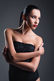 Studio fashion shot: gorgeous young girl wearing black body