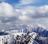 Winter snowy mountains and cloudy sky