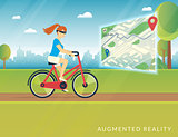 Young woman riding a bike and seeing bicycle path on the mobile augmented reality map
