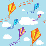 Seamless vector background with colorful kites in the blue sky. Seamless pattern, background, vector seamless texture