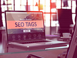 SEO Tags Concept on Laptop Screen.
