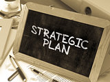 Strategic Plan Handwritten by white Chalk on a Blackboard.